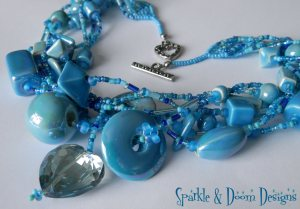 Multistrand Ceramic Bead Necklace with Crystal Heart (closeup)