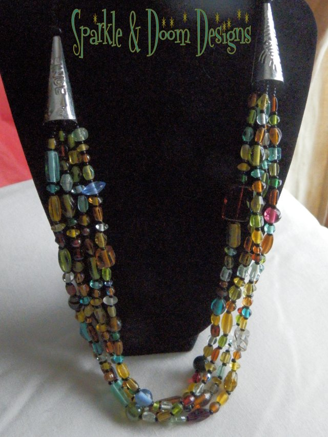 "On my 'model'... this is a long necklace at approx. 25"" long."