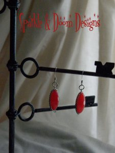 ruby framed with chain earrings