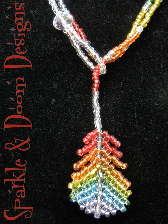 sparkly red-to-purple rainbow feather lariat with aurora borealis crystal charm