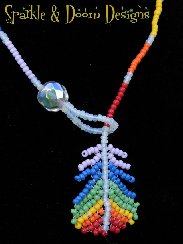 opaque purple-to-red rainbow feather lariat with aurora borealis crystal charm