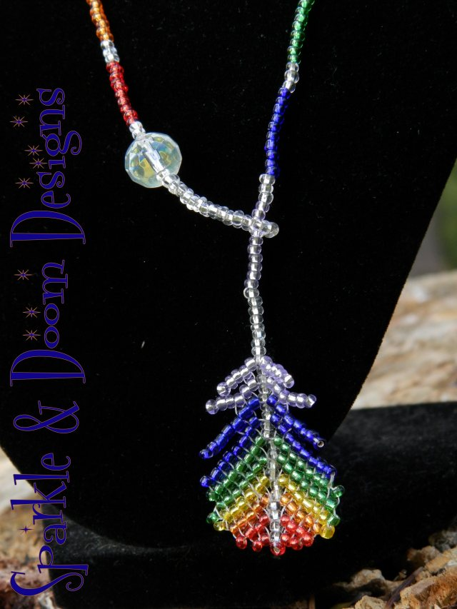 sparkly purple-to-red rainbow with aurora borealis crystal charm
