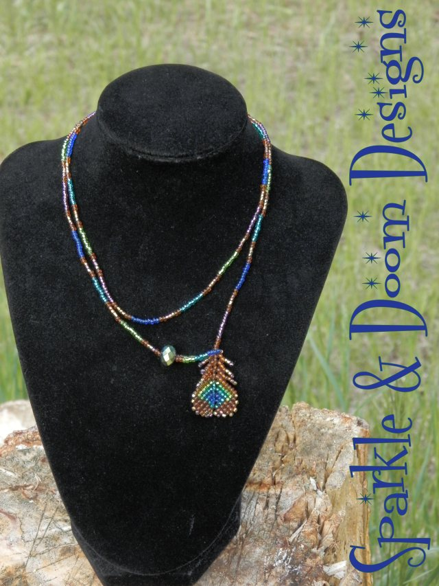 peacock feather lariat with green oilslick crystal charm