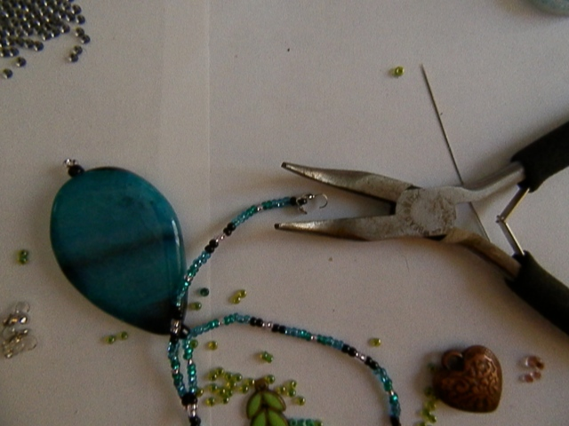 another tool you will need is a pair of jewelry pliers, or at least it makes things easier. :)