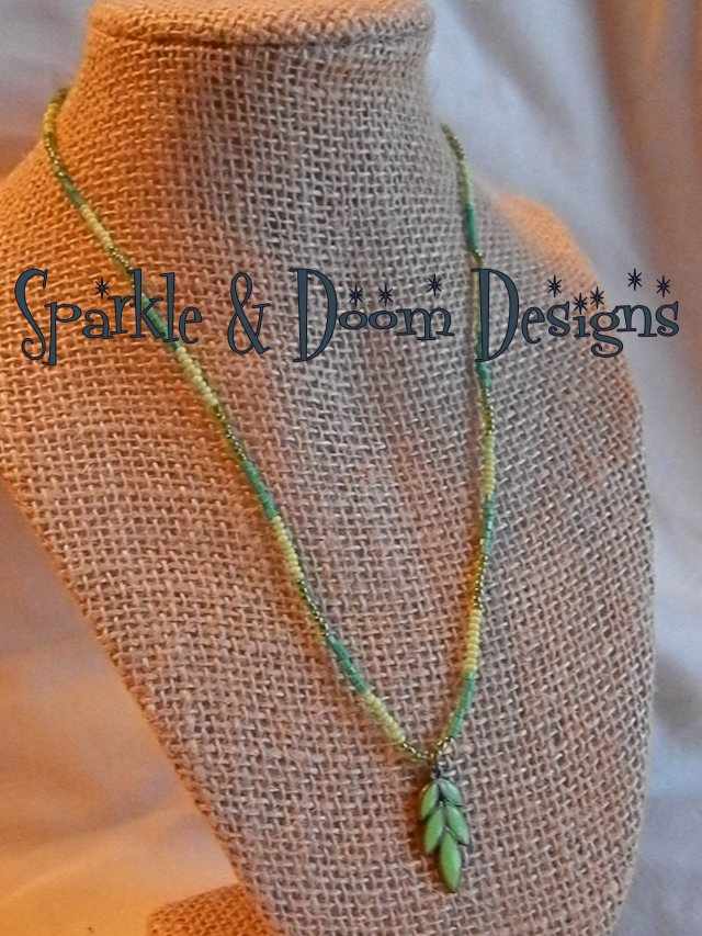 green enameledleaf with threedifferent green seed beads.