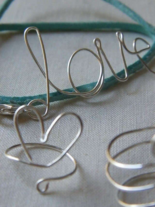 Wire Words & Shapes close up of Love Bracelet and Heart Ring