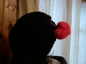 a hat I made for Marlene with heart pompom